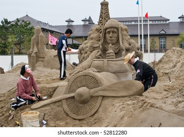 KAGOSHIMA, JAPAN - APRIL 30: Artists work on a sand sculpture of Charles Lindbergh in his  airplane at the Fukiage Sand sculpture  festival April 30, 2007 in Kagoshima, Japan.