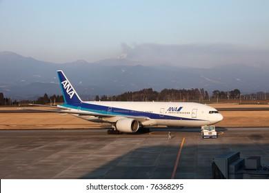 KAGOSHIMA, JAPAN - FEBRUARY 18: Recently active Shinmoedake volcano erupts as  ANA jet is on tarmac at Kagoshima Airport, February 18, 2011 in Kagoshima, Japan. Volcanic ash has disrupted air traffic