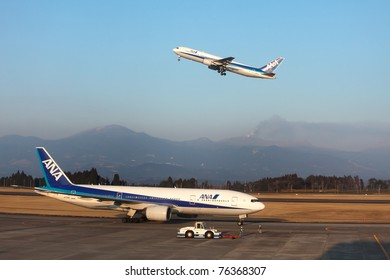 KAGOSHIMA, JAPAN - FEBRUARY 18: Recently active Shinmoedake volcano erupts as  ANA jet takes off from Kagoshima Airport,  February 18, 2011 in Kagoshima, Japan. Volcanic ash has disrupted air traffic.