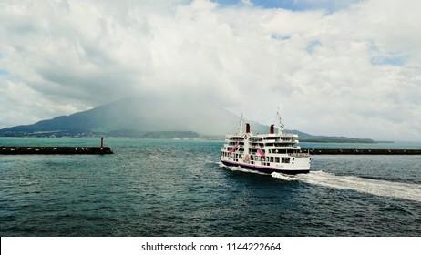 Kagoshima, Japan. Ferry going to Sakurajima island with active volcano in Kagoshima, Japan. Popular touristic destination of Kyushu island