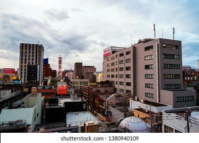 KAGOSHIMA, JAPAN - JULY 20, 2018: Aerial view of center of Kagoshima, Japan located at Kyushu island. Modern buildings at sunrise in the morning