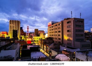KAGOSHIMA, JAPAN - JULY 20, 2018: Aerial view of center of Kagoshima, Japan located at Kyushu island. Modern buildings at night