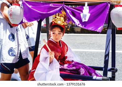 KAGOSHIMA, JAPAN - JULY 22, 2018: Religious festival at the streets of Kagoshima, Japan during the day. Kagoshima is a popular touristic city of Kyushu island. Girl wearing traditional clothes