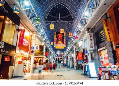 KAGOSHIMA, JAPAN - JULY 22, 2018:  Central shopping streets in Kagoshima, Kyushu, Japan at night. Illuminated shops and restaurants with various signs