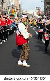 KAGOSHIMA JAPAN - NOVEMBER 3, 2010: People dance in symmetry during Ohara Matsuri Festival. Ohara Matsuri Festival is Kagoshima\'s biggest festival.