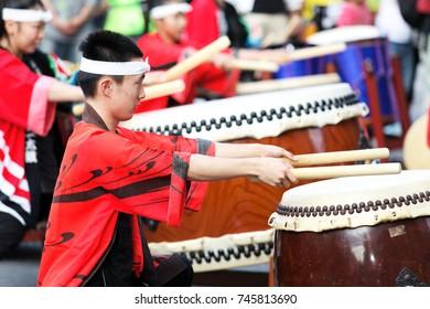 KAGOSHIMA, JAPAN - NOVEMBER 3, 2011: Young performers play Japanese Taiko Drum at Ohara Matsuri Festival. Ohara Matsuri Festival is Kagoshima's biggest festival is held on the November 2 and 3.