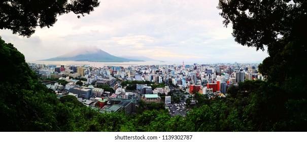 Kagoshima, Japan. View of mountain Sakurajima an active volcano. Aerial view of Kagoshima city in Japan in the morning