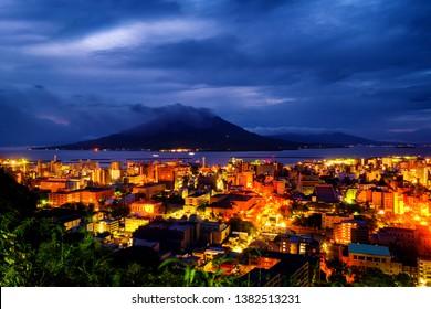 Kagoshima, Japan. View of mountain Sakurajima an active volcano. Aerial view of Kagoshima city in Japan at night