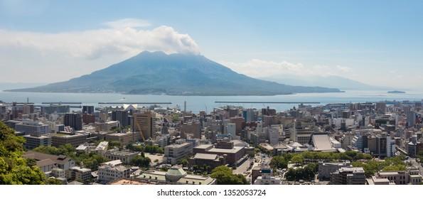 Kagoshima, Kyushu/Japan - May 12, 2018: Kagoshima City with Kagoshima Bay and erupted Vulcan Sakurajima on a clear summer day.
