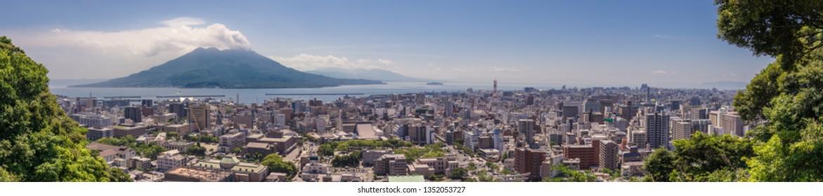 Kagoshima, Kyushu/Japan - May 12, 2018: Panorama of Kagoshima City with erupted Vulcan Sakurajima and Kagoshima Bay on a clear summer day.