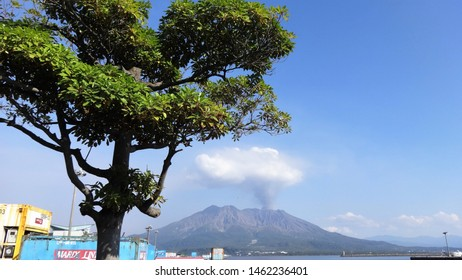 Kagoshima/Japan - October 23, 2014: a view of the beautiful harbor area of the city with the magnificent smoky volcano Sakurajima in the background.