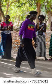 Kaguit vil., SENEGAL - APR 30, 2017: Unidentified Diola man stands in the circle and smiles during a traditional dance Kumpo in a Sacred Forest near Kaguit village