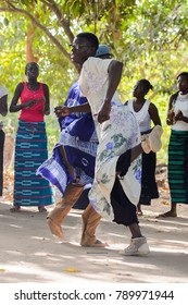 Kaguit vil., SENEGAL - APR 30, 2017: Unidentified Diola man in a dress moves during a traditional dance Kumpo in a Sacred Forest near Kaguit village