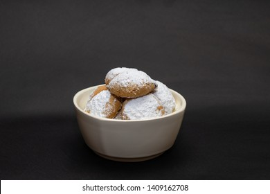 Kahk cookies served on a white plate, sprinkled with sugar  (Kahk is a traditional cookies in the arab world, served in Eid el fitr, a feast after Ramadan)