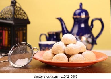 Kahk El Eid -  Cookies of El Fitr Islamic Feast - Biscuits with lantern and tea for iftar in Eid fitri