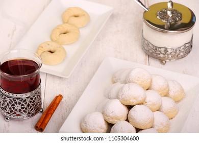 Kahk El Eid -  Cookies of Eid El Fitr Islamic Feast with sugar and cupt of tea for iftar in Eid fitri