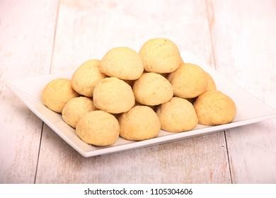 Kahk El Eid -  Cookies of Eid El Fitr Islamic Feast on wooden table