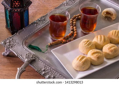 Kahk El Eid -  Cookies of Eid El Fitr with red tea for Eid Elfitr breakfast Islamic Feast