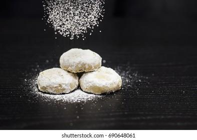 """Kahk feast """"Kahk El Eid"""" - Translation : Cookies of El Fitr Feast with sugar sprinkles falling on top"""