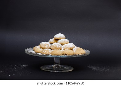 Kahk on a glass plate with sugar powder on top