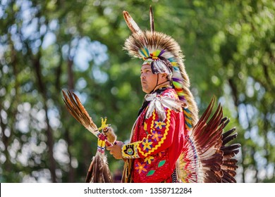 Kahnawake, Quebec, Canada - July 09, 2017 : Pow wow men's Traditional dancer at Kahnawake 27th Annual Echoes Of A Proud Nation Pow Wow in Kahnawake reserve. Seniors 18-44 years old category.