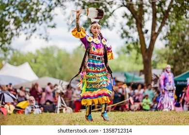 Kahnawake, Quebec, Canada - July 09, 2017 : Pow wow Women's Jingle dancer at Kahnawake 27th Annual Echoes Of A Proud Nation Pow Wow in Kahnawake reserve. Seniors 18-44 years old category.