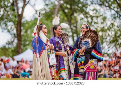 Kahnawake, Quebec, Canada - July 09, 2017 : Pow wow Women's Traditional dancers at Kahnawake 27th Annual Echoes Of A Proud Nation Pow Wow in Kahnawake reserve. Seniors 18-44 years old category.