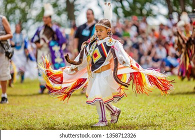 Kahnawake, Quebec, Canada - July 09, 2017 : Pow wow Girl's Fancy dancer at Kahnawake 27th Annual Echoes Of A Proud Nation Pow Wow in Kahnawake reserve.  Children category.