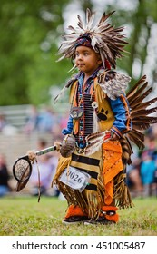 Kahnawake, Quebec, Canada - July 10, 2016 : Pow wow toddler boy dancer taking part in Kahnawake 26th Annual Echoes Of A Proud Nation Pow Wow in Kahnawake reserve. Tiny tots category.