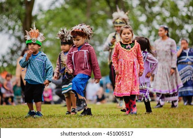 Kahnawake, Quebec, Canada - July 10, 2016 : Pow wow little kids take part in Kahnawake 26th Annual Echoes Of A Proud Nation Pow Wow in Kahnawake reserve