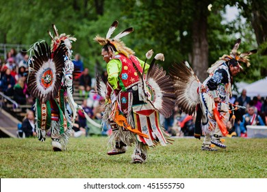 Kahnawake, Quebec, Canada - July 10, 2016 : Pow wow elder men dancers take part in Kahnawake 26th Annual Echoes Of A Proud Nation Pow Wow in Kahnawake reserve. Elder men 45-59 years old category.
