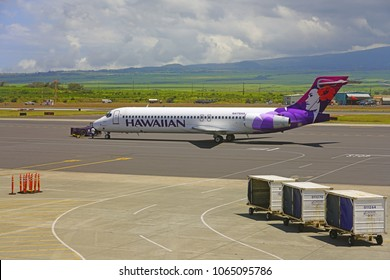 KAHULUI, HI -29 MAR 2018- A Boeing 717 airplane from Hawaiian Airlines (HA) at the Kahului Airport (OGG) on the island of Maui in Hawaii near the Haleakala volcano.