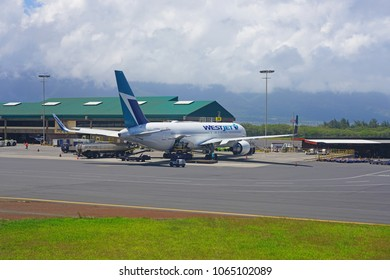 KAHULUI, HI -29 MAR 2018- A Boeing 767 airplane from Canadian airline Westjet (WS) at the Kahului Airport (OGG) on the island of Maui in Hawaii near the Haleakala volcano.
