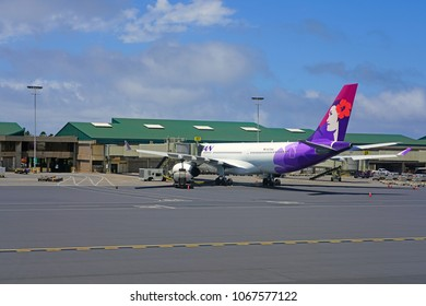 KAHULUI, HI -29 MAR 2018- An airplane from Hawaiian Airlines (HA) at the Kahului Airport (OGG) on the island of Maui in Hawaii near the Haleakala volcano.