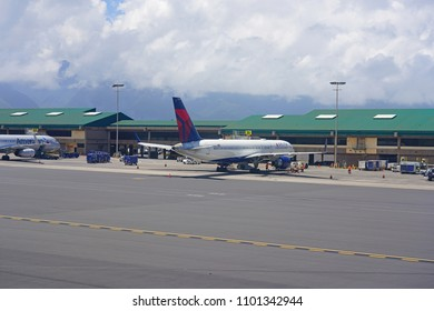 KAHULUI, HI -29 MAR 2018- An airplane  at the Kahului Airport (OGG) on the island of Maui in Hawaii near the Haleakala volcano.