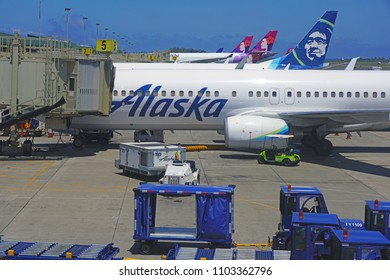 KAHULUI, HI -29 MAR 2018- An airplane from Alaska Airlines (AS) at the Kahului Airport (OGG) on the island of Maui in Hawaii near the Haleakala volcano.