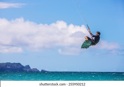 KAHULUI, HI /USA - AUGUST 30: California kite surfer Robert Blum practicing off Kanaha Beach on August 30, 2014 in Kahului, Maui, USA.