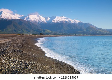Kaikoura coast with snow capped mountain range of southern alps and blue sea in Kaikoura, New Zealand