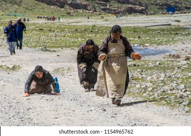 Kailash area, Tibet / China - Aug 2017: Tibetans pilgrims during the second day of ritual kora (yatra) around sacred Mount Kailash. Ngari scenery in West Tibet. Sacred place for Buddha pupils.