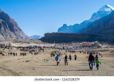 Kailash area, Tibet / China - Aug 2017: Tibetans pilgrims during ritual kora (yatra) around sacred Mount Kailash. Ngari scenery in West Tibet. Sacred place for Buddha pupils.