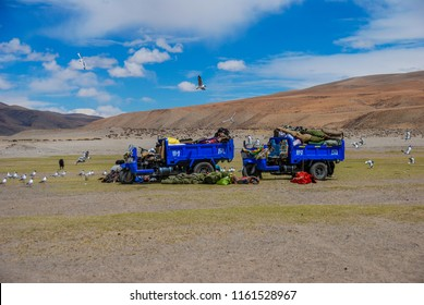 Kailash area, Tibet / China - Aug 2017: Tibetans pilgrims with tractors during ritual kora (yatra) around sacred Mount Kailash. Ngari scenery in West Tibet. Sacred place for Buddha pupils.