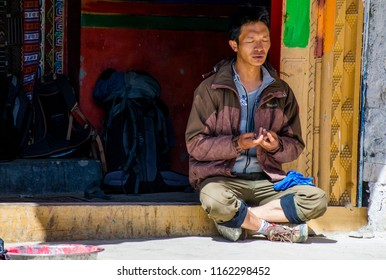 Kailash area, Tibet / China - Aug 2017: Tibetan man meditating during the second day of ritual kora (yatra) around sacred Mount Kailash. Ngari scenery in West Tibet. Sacred place for Buddha pupils.