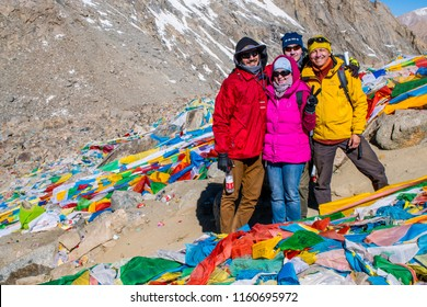 Kailash area, Tibet / China - May 2016: European tourists during the second day of ritual kora (yatra) around sacred Mount Kailash. Ngari scenery in West Tibet. Sacred place for Buddha pupils.