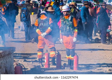 Kailash area, Tibet / China - May 2016: Two firemans during the second day of ritual kora (yatra) around sacred Mount Kailash. Ngari scenery in West Tibet. Sacred place for Buddha pupils.