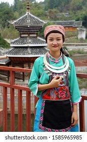Kaili, China - October 24, 2019: At Xijia Village, portrait of a young girl wearing typical clothes of Miao minority