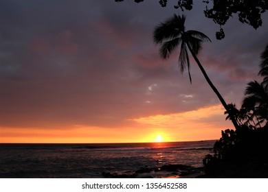 Kailua Kona, Hawaii / USA - August 4th, 2017: Beautiful sunset at Honl's Beach in Kailua Kona on the big island of Hawaii