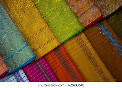 Kain Songket is a type of cloth made of silk or cotton interwoven with metallic threads which form intricate patterns and motifs.