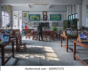 Kaiping, Guangdong/China-April 9th 2011: man standing in a community library.