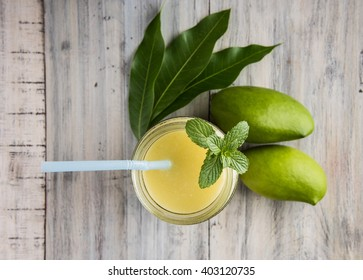 Kairi panha OR Panna OR Raw Mango Drink is a traditional and most popular Indian summer beverage served in a glass over colourful or wooden background. Selective focus