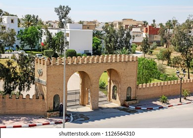 KAIROUAN, TUNISIA - JUNE 24, 2018: Castellated entrance to an International hotel. Kairouan is a UNESCO World Heritage site, founded by the Umayyads around 670 in Tunisia.